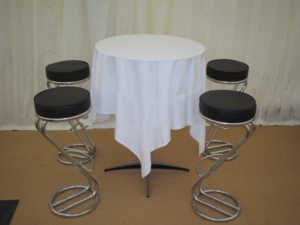 table and chairs in a marquee party
